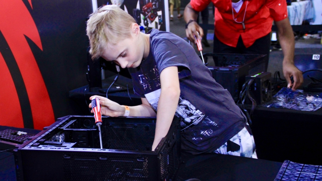 Kid building a PC at the MSI Gaming PC Workshop